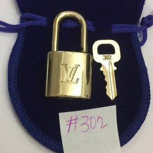 Authentic Louis Vuitton Lock and key 302